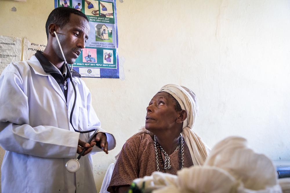 INDIVIDUAL(S) PHOTOGRAPHED: Getnet Siyoum (left) and Fentanesh Bogale (right). LOCATION: Mecha Health Center, Bahir Dar, Ethiopia. CAPTION: Clinical Nurse Getnet Siyoum conducts a visit with Fentanesh Bogale, who has insurance through the CBHI program.