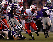 Nebraska running back Brandon Jackson (32) rushes up field past Kansas State nose tackle Steven Cline (99) in the second half at Bill Snyder Family Stadium in Manhattan, Kansas, October 14, 2006.  The Huskers beat the Wildcats 21-3.<br />