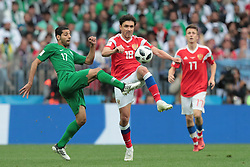June 14, 2018 - Moscow, Russia - Midfielder Taiseer Aljassam of Saudi Arabia National team and midfielder Yuri Zhirkov of Russia National team during the group A match between Russia and Saudi Arabia at the 2018 soccer World Cup at Luzhniki stadium in Moscow, Russia, Tuesday, June 14, 2018. (Credit Image: © Anatolij Medved/NurPhoto via ZUMA Press)