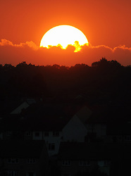 © Licensed to London News Pictures. 05/09/2013<br /> After another hot day in the UK today (05.09.2013) The sun dramatically sets this evening over the London borough of Bromley,Greater London.<br /> Photo credit :Grant Falvey/LNP