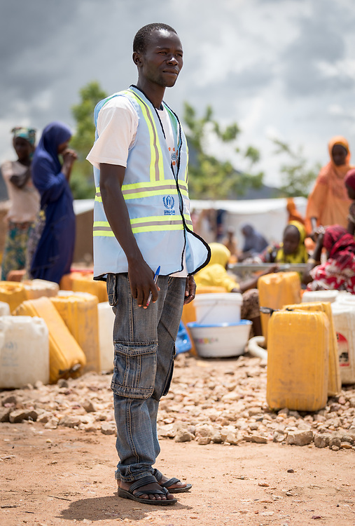 30 May 2019, Mokolo, Cameroon: Nigerian refugee Barka Nuhu is 34 years old. Originally from Ngoshe village, he serves today as hygiene promoter in the Minawao camp, in collaboration with the Lutheran World Federation. 15 refugees currently serve at the camp's various water points. The Minawao camp for Nigerian refugees, located in the Far North region of Cameroon, hosts some 58,000 refugees from North East Nigeria. The refugees are supported by the Lutheran World Federation, together with a range of partners.