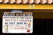 Sign identifying a painter's workshop at the Village Artisanal de Ouagadougou, a cooperative that employs dozens of artisans who work in different mediums, in Ouagadougou, Burkina Faso, on Monday November 3, 2008.