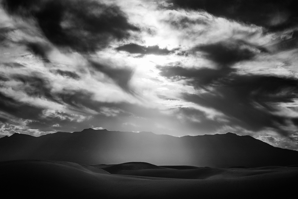 Dramatic light coming through the clouds at White Sands National Monument in New Mexico. ©justinalexanderbartels.com