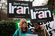Protesters listening to speakers holding their placards. Stop The War Coalition rally outside the US Embassy in London. Scuffles broke out during the protest, as opposite sides of the arguement shouted each other down. The protest is in response to inflamatory language being used by the US and UK concerning Iran and Syria. Free Iran supporters were came in strong numbers, to listen to speakers.