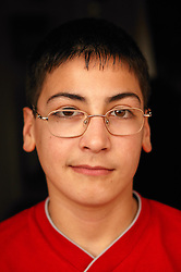 Portrait of a young teenage boy wearing glasses,