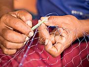 15 JUNE 2105 - NARATHIWAT, NARATHIWAT, THAILAND:  Fishermen repair their nets in Narathiwat.      PHOTO BY JACK KURTZ