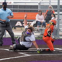 Aztec Tiger Shaylee Wooley (7) scores as Amber Mecale (3) catcher for the Miyamura Patriots misses the tag at home Wednesday in Gallup.