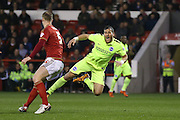 Nottingham Forest defender Matthew Mills (5)  fouls Brighton striker, Tomer Hemed (10) during the Sky Bet Championship match between Nottingham Forest and Brighton and Hove Albion at the City Ground, Nottingham, England on 11 April 2016. Photo by Simon Davies.