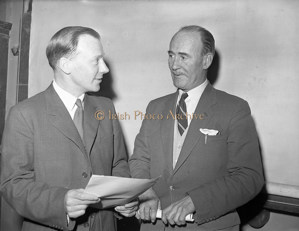 """10/03/1959<br /> 03/10/1959<br /> 10 March 1959<br /> C.C. Wakefield (Castrol) lecture. Mr. S.E. Holmes, A.R.I.C., A.F.I.N.S.P., (left) of C.C. Wakefield, London, who lectured on """"Lubricants for Road Transport"""" to members of the Institute of Motor Industry at Bolton Street Technical School, Dublin, photographed with the President of the Institute, Mr. Kevin Kenna before the lecture."""