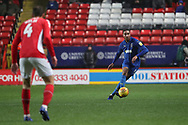 AFC Wimbledon defender Rod McDonald (26) dribbling during the EFL Sky Bet League 1 match between Charlton Athletic and AFC Wimbledon at The Valley, London, England on 15 December 2018.
