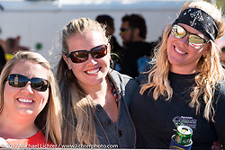Spectators at the annual cole slaw wrestling day at the Cabbage Patch in New Smyrna Beach during Daytona Bike Week. New Smyrna Beach, FL. USA. Wednesday March 15, 2017. Photography ©2017 Michael Lichter.