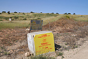 A warning sign at the entrance to a military shooting range Photographed in the Northern Negev desert, Israel