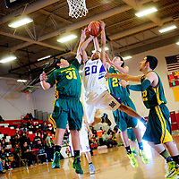 121413  Adron Gardner/Independent<br /> <br /> Miyamura Patriot Daquan Walker (20) attempts a field goal surrounded by Jemez Valley Warriors during the Eddie Peña Classic Basketball Tournament in Grants Saturday.