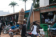 Central African Republic. August 2012. Bangui outskirts - market with man carring boiled eggs to sell