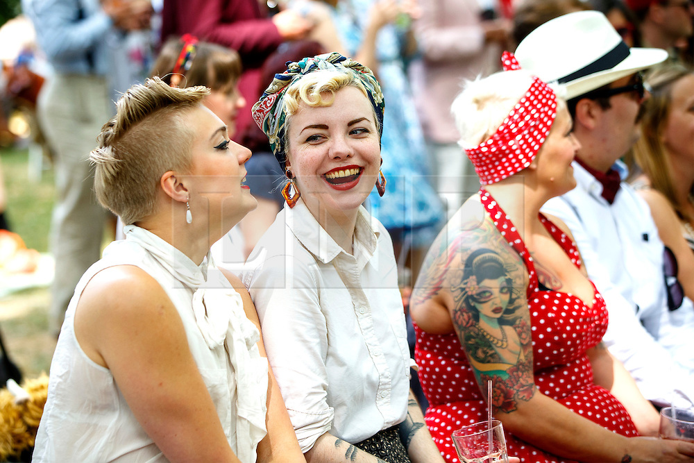 © Licensed to London News Pictures. 11/07/2015. London, UK. Guests attending 'The Chap Olympiad' in Bedford Square, London on July 11, 2015. The Chap Olympiad is a light-hearted social sporting event aimed at revisiting the fashions and pastimes of the polite aspects of 1920's to 1950's England. Photo credit: Tolga Akmen/LNP