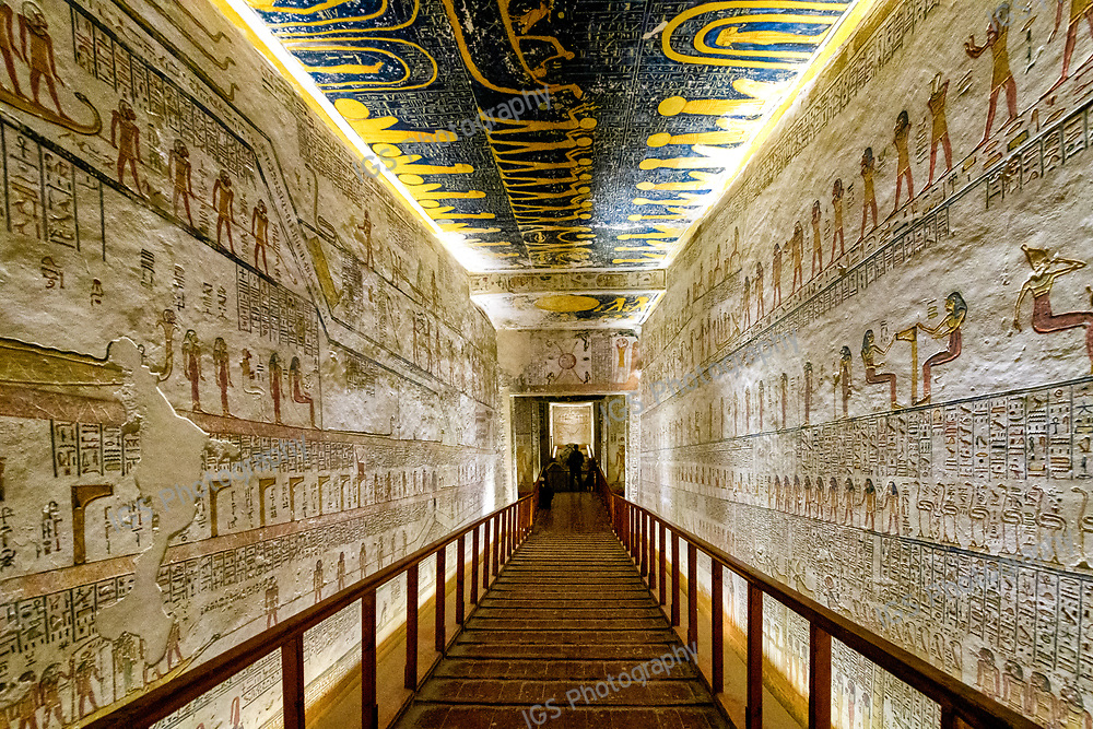 Hieroglyphics on either side of the ramp leading through the fifth corridor towards the burial chamber of Ramses VI