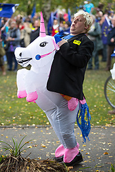 © Licensed to London News Pictures . 01/10/2017. Manchester, UK. Boris Johnson impersonator on a unicorn . Thousands of people take part in an anti Brexit pro EU demonstration at All Saints Park in Manchester during the Conservative Party Conference , which is taking place at the Manchester Central Convention Centre . Photo credit: Joel Goodman/LNP