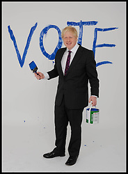 The Mayor of London Boris Johnson painting his vote on the studio background during a portrait shoot in the studio, London, United Kingdom. Friday, 30th March 2012. Picture by Andrew Parsons / i-Images