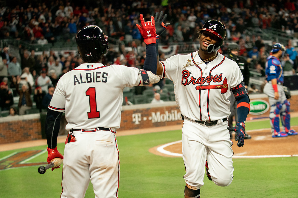 Ronald Acuna Jr. celebrates scoring with Ozzie Albies during the home opener against the Chicago Cubs on Monday, April 1, 2019. The Braves won 8-0. Photo by Kevin D. Liles/Atlanta Braves