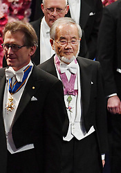 """Nobelpreisverleihung 2016 in der Konzerthalle in Stockholm / 101216 ***Japanese scientist Yoshinori Ohsumi (C) arrives at a concert hall in Stockholm to attend the Nobel Prize Award Ceremony on Dec. 10, 2016. Ohsumi was awarded the Nobel prize in physiology or medicine for elucidating """"autophagy,"""" an intracellular process that degrades and recycles proteins."""