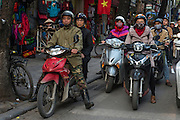 Motorcycle is the preferred transportation in Hanoi, the old French capital of Indochine.