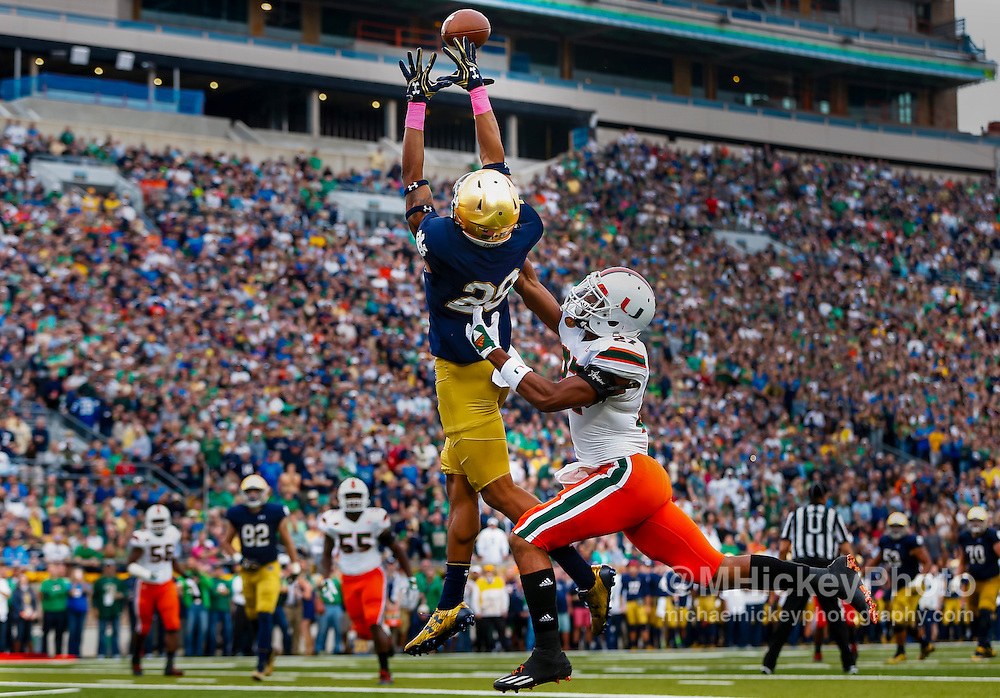 SOUTH BEND, IN - OCTOBER 29: Kevin Stepherson #29 of the Notre Dame Fighting Irish goes up for the ball as Ryan Mayes #27 of the Miami Hurricanes defends at Notre Dame Stadium on October 29, 2016 in South Bend, Indiana. Notre Dame defeated Miami 30-27. (Photo by Michael Hickey/Getty Images) *** Local Caption *** Kevin Stepherson; Ryan Mayes