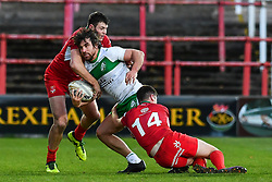 11th November 2018 , Racecourse Ground,  Wrexham, Wales ;  Rugby League World Cup Qualifier,Wales v Ireland ; Tyrone McCarthy of Ireland is tackled by Elliott Jenkins of Wales <br /> <br /> <br /> Credit:   Craig Thomas/Replay Images