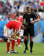Gareth Bale of Wales prepares to take a free-kick as referee Svein Oddvar Moen of Norway looks on. Euro 2016, Wales v Slovakia at Matmut Atlantique , Nouveau Stade de Bordeaux  in Bordeaux, France on Saturday 11th June 2016, pic by  Andrew Orchard, Andrew Orchard sports photography.