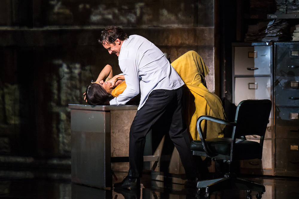 """LONDON, UK, 17 October, 2016.  Jacques Imbrailo (in white, as """"Zurga"""") and Claudia Boyle (in yellow, as """"Leila"""") rehearse for the revival of director Penny Woolcock's production of Bizet's opera """"The Pearl Fishers"""" at the London Coliseum for the English National Opera.  The production opens on 19 October."""