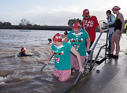 © Licensed to London News Pictures. 14/12/2019. Clevedon, North Somerset, UK. Homeless charity Crisis holds its first Icebreaker Challenge in the Bristol area, with fundraisers in fancy dress swimming in the cold waters of Clevedon's Marine Lake. The event was opened by adventurer and outdoor swimmer Lindsey Cole, who this December is walking along the south coast path to Bristol, encouraging others to join her swimming in the sea for the homeless. Crisis is a national charity for homeless people which helps people directly out of homelessness and campaigns for the social changes needed to solve it altogether. Crisis provides services across Britain with help for people experiencing homelessness all year round. Photo credit: Simon Chapman/LNP.