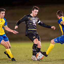 BRISBANE, AUSTRALIA - AUGUST 26: Alex Janovsky of Moreton Bay is tackled by Michael Angus of the Strikers during the NPL Queensland Senior Men's Semi Final match between Brisbane Strikers and Moreton Bay Jets at Perry Park on August 26, 2017 in Brisbane, Australia. (Photo by Patrick Kearney)