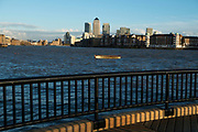 View across the River Thames from Wapping towards the financial district of Canary Wharf in London, England, United Kingdom.