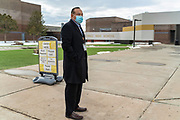 Quincy Natay, Superintendent of Chinle Unified School District stands for a portrait outside of the high school.