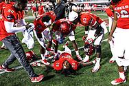 UNLV Rebels defensive back Robert Jackson (24) lies on the ground as teammates celebrate after defeating the Hawaii Warriors 31-23 at Sam Boyd Stadium in Las Vegas, Saturday, Nov. 4, 2017. (Joel Angel Juárez / Las Vegas Review-Journal)