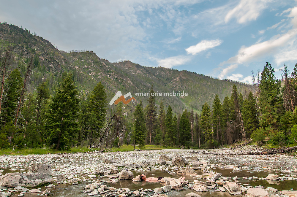 Man enjoying hot spring at Sheepeater Camp, Middle Fork of the Salmon River, Idaho.
