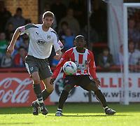 Photo: Daniel Hambury.<br />Brentford v Bristol City. Coca Cola League 1. 07/10/2006.<br />Brentford's Sam Tillen and Bristol City's Jamie McCombe battle.