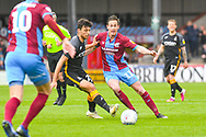 Josh Morris of Scunthorpe United (11) passes the ball during the EFL Sky Bet League 1 match between Scunthorpe United and Bradford City at Glanford Park, Scunthorpe, England on 27 April 2019.