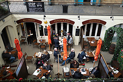 © Licensed to London News Pictures. 12/04/2021. London, UK. Members of the public eat and drink at Punch and Judy in Covent Garden in central London. From today restaurants will reopen with outdoor dining following the easing of lockdown restrictions. Photo credit: George Cracknell Wright/LNP