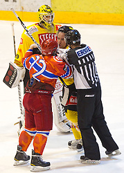Andrej Zidan of Acroni Jesenice and Benoit Gratton of Vienna in fight in last minute during ice-hockey match between HK Acroni Jesenice and EV Vienna Capitals in 13th Round of EBEL league, on October 22, 2010 at Podmezakla, Jesenice, Slovenia. (Photo By Vid Ponikvar / Sportida.com)