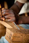 Wood carving at a workshop in the town of Dschang, Cameroon