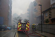Fire fighters tackle a fire in a block of flats in Brodlove Lane in Wapping, London, United Kingdom. According to sources the fire was possibly due to gas cylinders which were in a builders yard at the base of the building. A local resident said that there were often fires in this area, though he didn't know what was the cause. (photo by Mike Kemp/In Pictures via Getty Images)