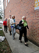 CHARLOTTESVILLE, VA - FEBRUARY 14: From right, Yeardley Love's mother Sharon Love and sister Lexie are escorted with family members to the Charlottesville Circuit courthouse for the George Huguely trial. Huguely was charged in the May 2010 death of his girlfriend Yeardley Love. She was a member of the Virginia women's lacrosse team. Huguely pleaded not guilty to first-degree murder. (Credit Image: © Andrew Shurtleff/