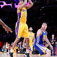 11 April 2014: Los Angeles Lakers forward Wesley Johnson (11) takes a jump shot over Golden State Warriors guard Klay Thompson (11) during the Golden State Warriors 112-95 victory over the Los Angeles Lakers at the Staples Center, Los Angeles, California, USA.