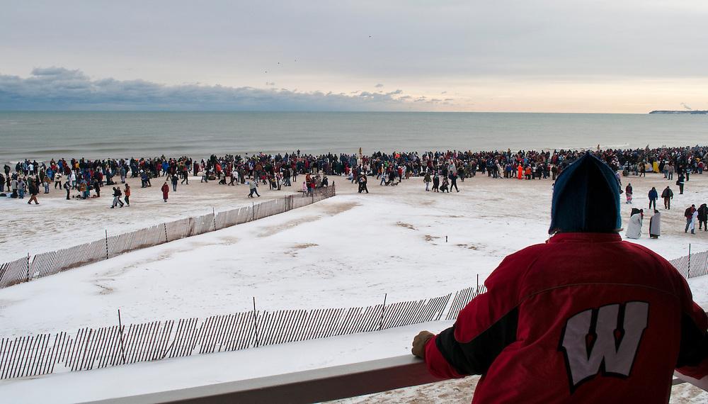 Hundreds gather for the annual polar bear plunge at Bradford Beach in Milwaukee, Friday, Jan. 1 2010.