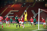 Charlton's Goalkeeper Ben Amos saves from a corner during the EFL Sky Bet League 1 match between Charlton Athletic and Rochdale at The Valley, London, England on 12 January 2021.