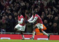 Photo: Olly Greenwood.<br />Arsenal v Bolton Wanderers. The FA Cup. 28/01/2007. Arsenal's Kolo Toure celebrates scoring with Emmanuel Adebayor