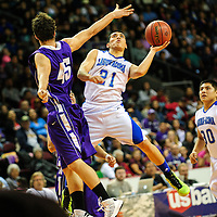 031313  Adron Gardner/Independent<br /> <br /> Laguna Acoma Hawk Anthony Carpio (21) uses the left hand around Santa Rosa Lion Miguel Sisneros (45) during the 2A New Mexico High School Basketball tournament quarterfinals at Santa Ana Star Center in Rio Rancho Wednesday.