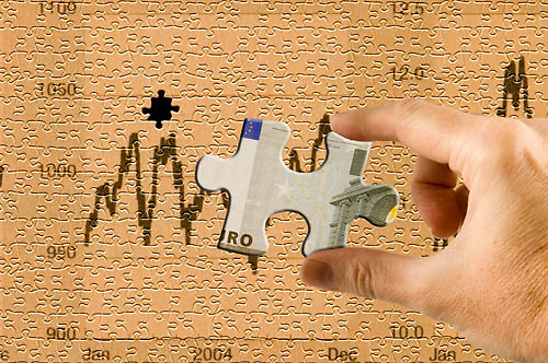 euro and stocks and shares concept, jigsaw piece of a euro note with a jigsaw of stocks and share graphs behind<br />