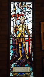 © Licensed to London News Pictures. 05/01/2015<br /> This window commemorates the 40th anniversary of the Battle of Britain.<br />  St George's RAF chapel in Biggin Hill is facing closure after the Ministry of Defence decided to pull funding. <br /> The chapel, along A233 Main Road,Biggin Hill,Kent could close from March next year if replacement funding is not found. <br />  The names of 454 servicemen operating from Biggin Hill who lost their lives in World War II are commemorated in the church. <br /> Also flanking the entrance are two full size replicas of a Spitfire and a Hurricane 'gate guardians'. <br /> The Chapel also has  Stained glass windows depicting a variety of aviation scenes some designed by Hugh Easton. <br /> <br /> <br /> <br /> (Byline:Grant Falvey/LNP)