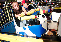 """SEYMOUR, CT- 23 SEPT 2007- 092307JT01- .At left, Kaleb Ouellette, 4, of Bristol, and Ryan Finch, 8, of Milford, react as they ride the """"Kiddie Whip"""" ride at the Seymour's 43rd annual Pumpkin Festival at French Memorial Park on Sunday..Josalee Thrift / Republican-American"""